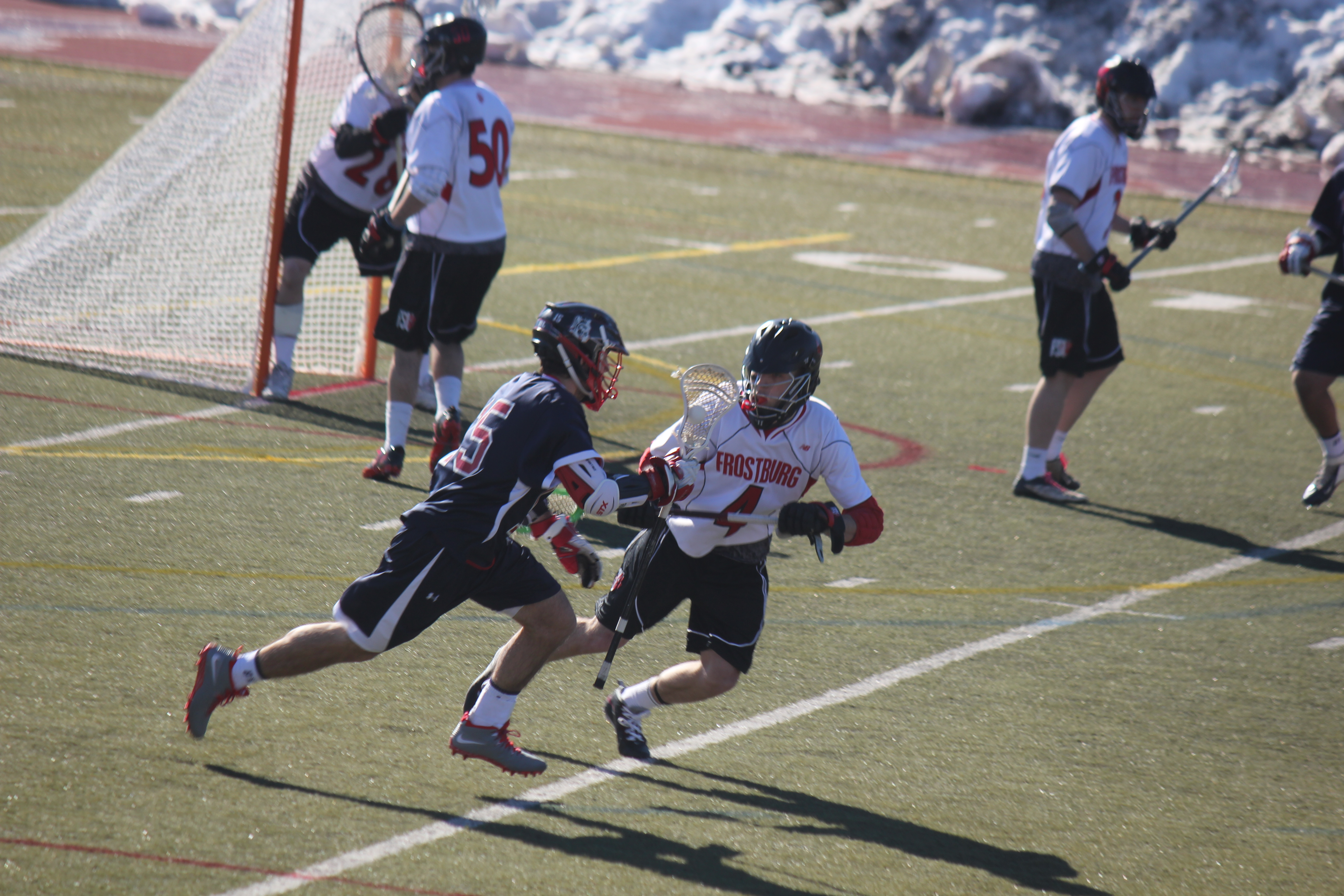Senior midfielder Andy Luhmann had an assist, a caused turnover, and two groundballs in the home opener. (Brandon Holmes/TBL)