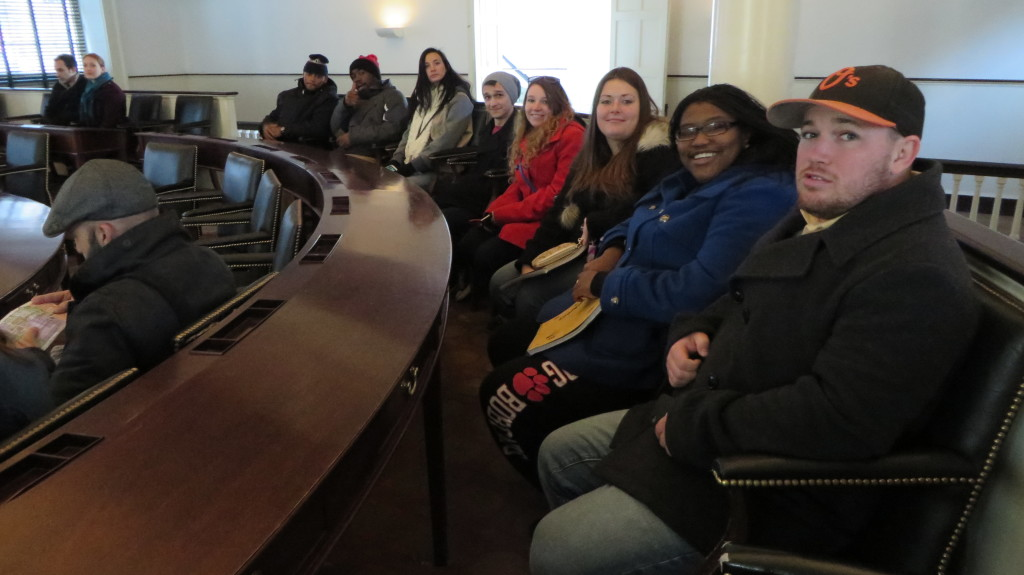 The group of students sit in Independence Hall (Dr. Sheri Whalen).
