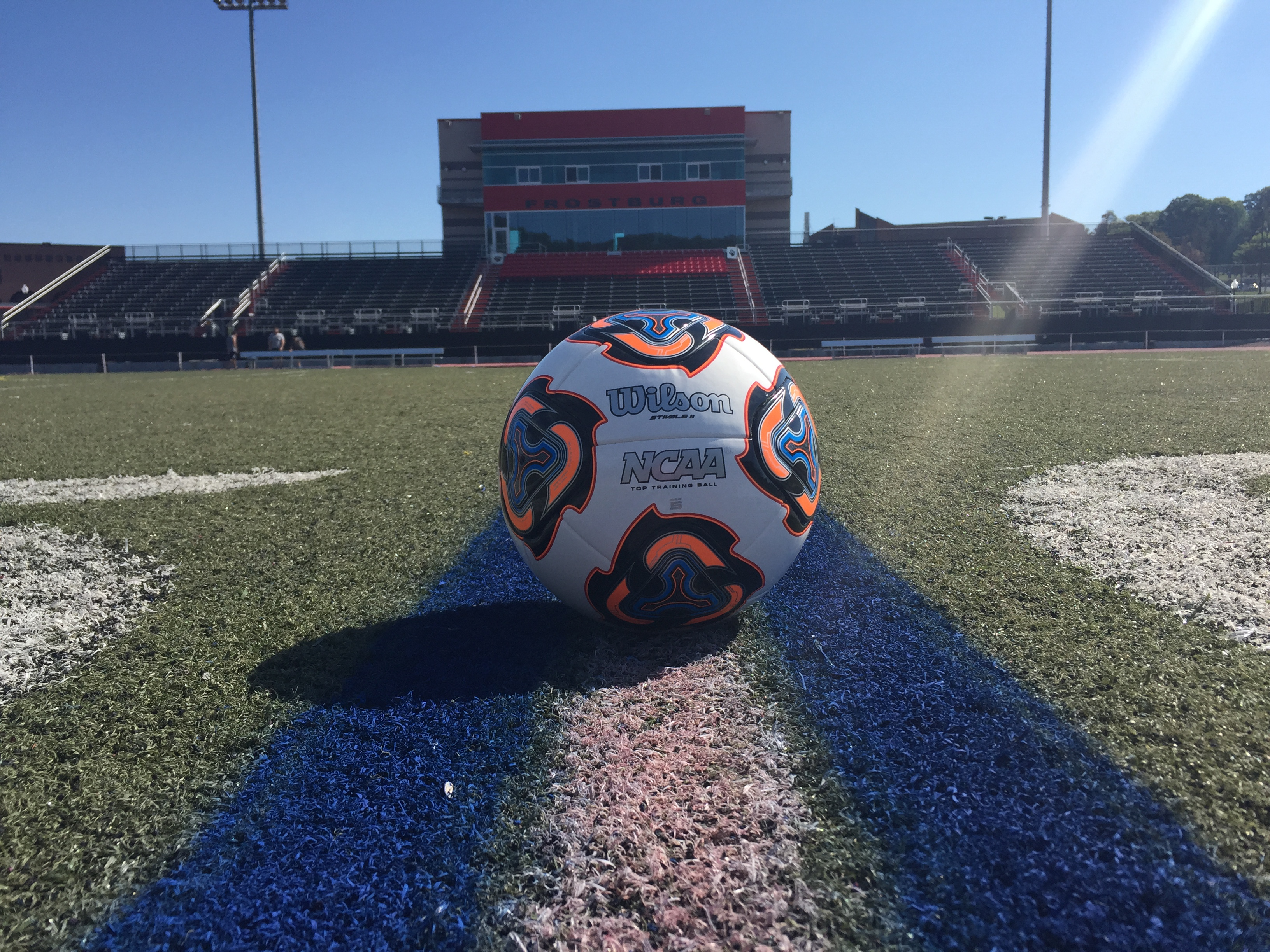NCAA Soccer Ball on home field.  (Mia Williams)