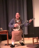 Massek, portraying 1930s folk musician Sarah Ogan, performs the play and plays the banjo on stage. (Tiaju McCalup/TBL)