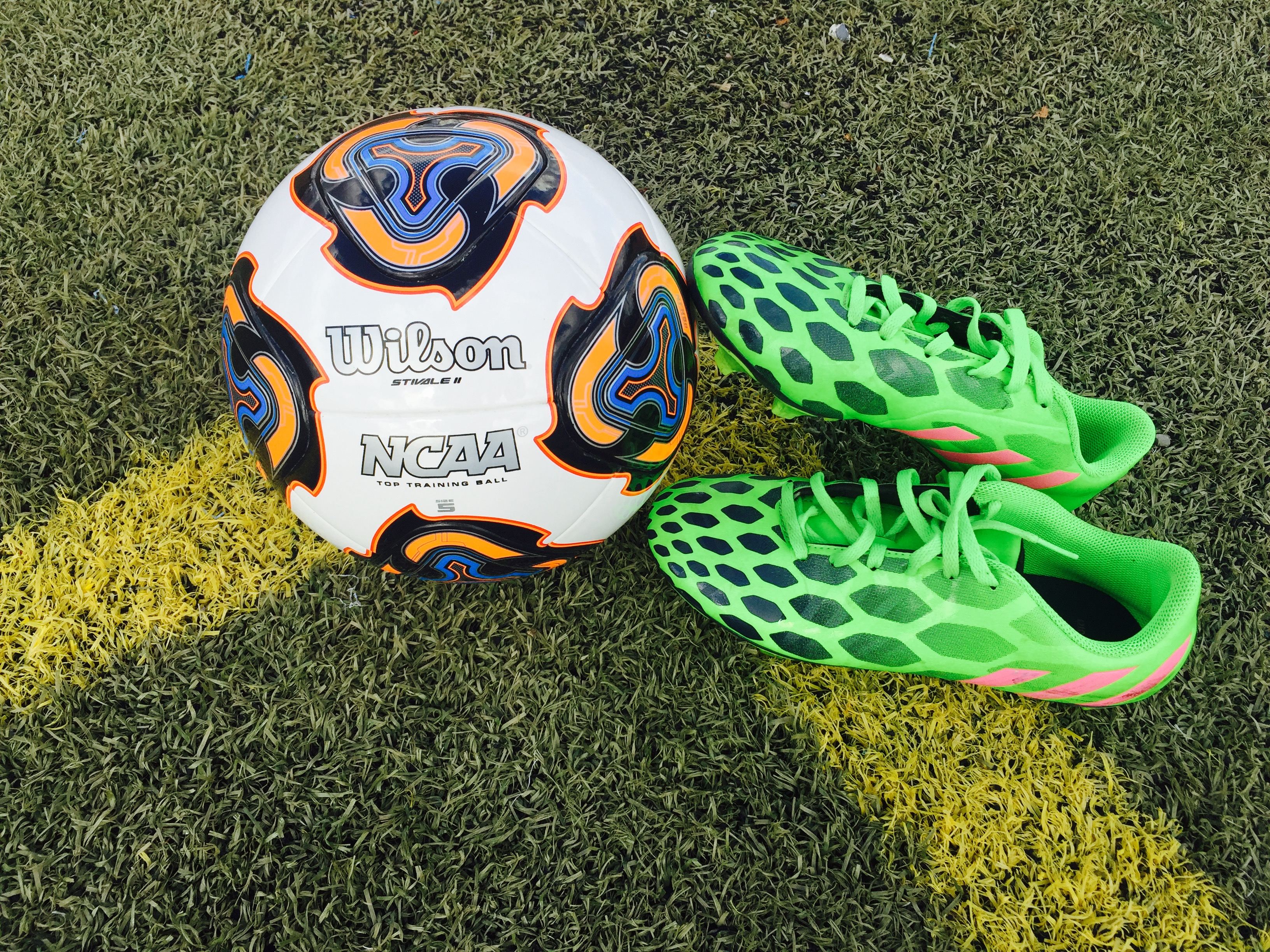 Women's soccer cleats with NCAA soccer ball. Taken by Mia Williams