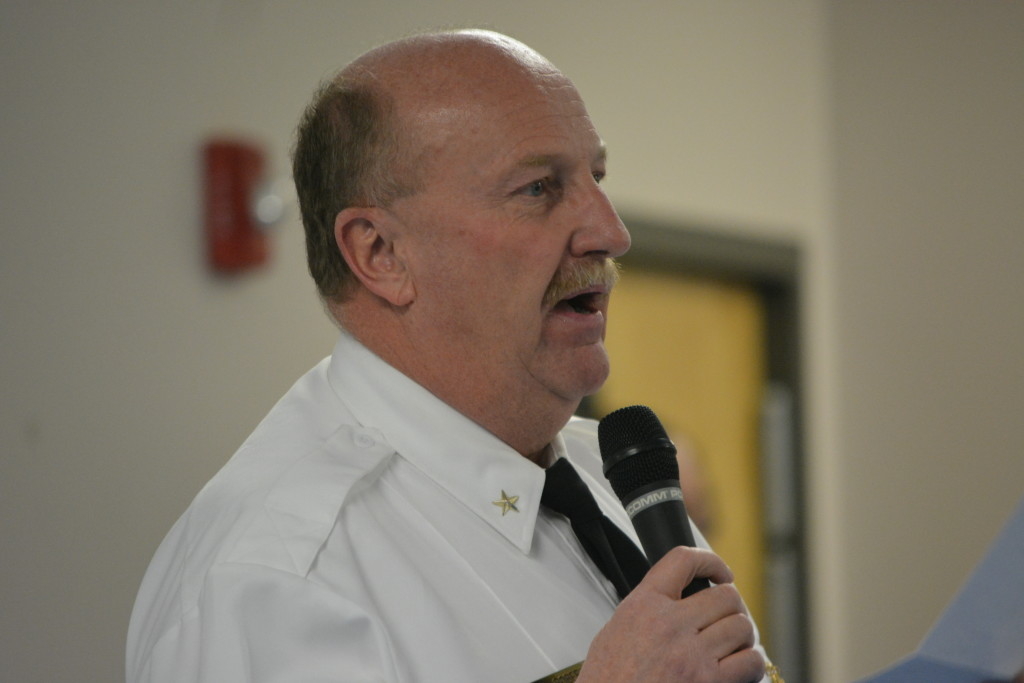 Allegany County Sherriff Craig Robertson addresses the crowd in the Midland Fire Hall (TBL/Nick DeMichele).