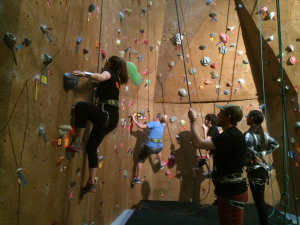 Students climb the rock wall in FSU's P.E. Center. (Madie Wilson/TBL)