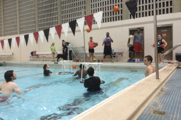 Students participate in a water basketball shootout .(Madie Wilson/TBL)