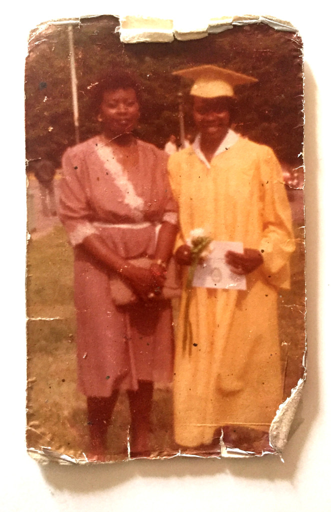 Joan, right, pictured with sister Marjorie, graduates from Eastern High School. Courtesy of the Charlton family.
