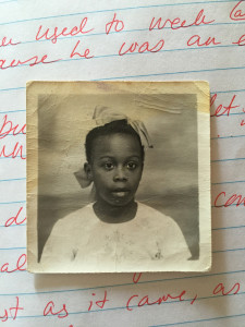 A school photo of a young Joan Charlton rests on the interview notes of ENGL 436 students in Sonia Charlton's home. Photo courtesy of the Charlton family.