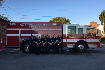 Student Firefighter gather at the station located on Water St. Back row, left to right: Landos Wallace, Jr.; Roger Willcox; Bre Lyons, Lydia Dickmyer; Brett Weikort; Sam Lohff. Front row, left to right: Victoria Snyder; Brian Long; Mike Moretti. Not in photo: Mack Schwarz and Albert Taylor. (TBL/ Madie Wilson)