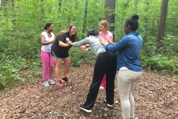 """Shawn Golden-Llewellyn, Director of FSU's Counseling & Psychological Services,   oversees the """"commitment bridge"""" activity at Camp Allegheny. (TBL/Nick DeMichele)"""