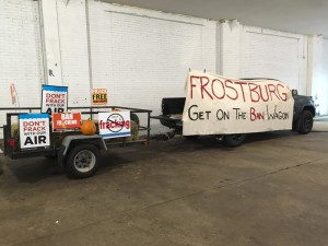 """An actual wagon and a 13-foot-long banner reading, """"Frostburg: Get on the Ban Wagon"""" at the rally. (Madie Wilson/ TBL)"""