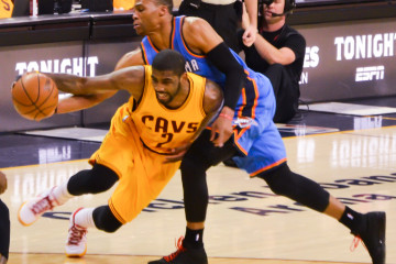Russell Westbrook defends Kyrie Irving in NBA action. (Flickr/Erik Drost)