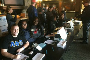Brothers of Alpha Phi Omega helping with registration