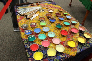 The colored sand and tools used to create the mandala. (TBL/Nicole Leighty)