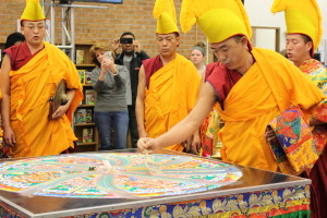 The mandala is being swept away during the closing ceremony. (TBL/Nicole Leighty)