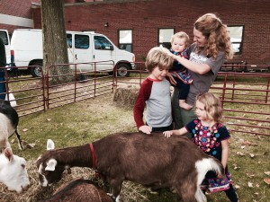 Leanna Koch enjoys petting the goats with her children Billy (left) and Leanna (right).