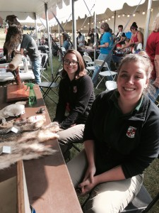 Two naturalists from Rocky Gap State Park, Megan Manes (left) and Paige Vance (right) hosting their informative booth.