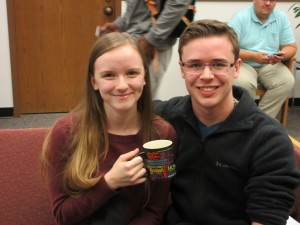 Tiffany Gulick and Daniel Steel celebrate their raffle win of the banned books mug.
