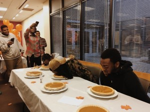 The three contestants competing in the pumpkin pie eating contest. Photo credit: Torie Costa