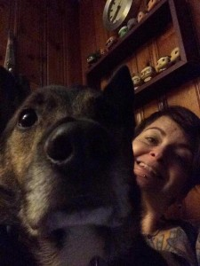 Small poses for a selfie with her dog.