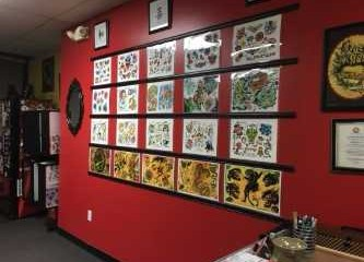 Inside the lobby of Independent Ink, unique tattoo illustrations cover the walls.